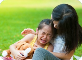 Daughter crying with mum